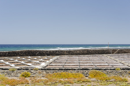 desalination: Traditional methods of sea salt production in Salinas del Carmen, Fuerteventura. Production from ocean water. Stock Photo