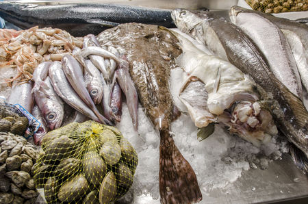 Fresh seafood on ice at the fish market.