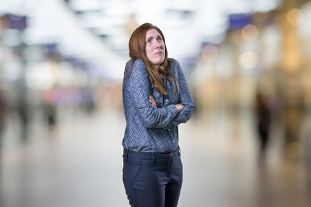 provoked: Pretty young businesswoman is angry.