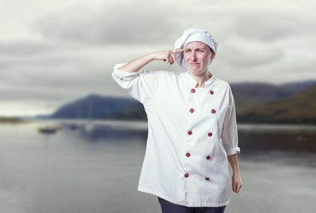 overwhelmed: Young woman chef overwhelmed, she has a lot of probems.