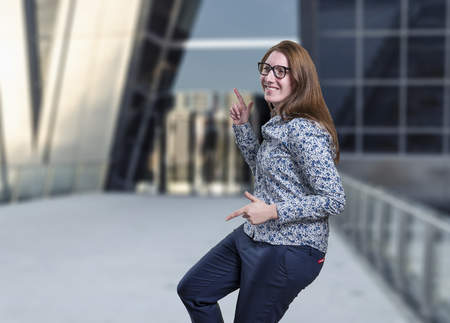 Pretty business woman dancing with glasses