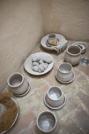 White ancient pots of ceramic on a floor Archivio Fotografico