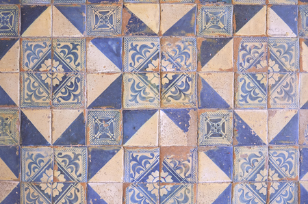Ancient wall of patchwork pattern from colorful Moroccan, Portuguese tiles, Valencian, Tile, ornaments, Surface textures Stockfoto