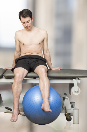 Man patient is doing an active exercise of tight hamstrings
