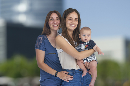 Lesbian love, young lesbian mothers with their baby. Homosexual family