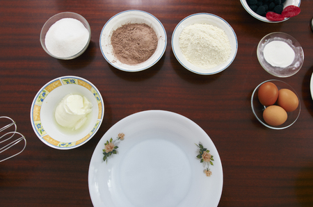 The process of making pie dough by hand. Baking cake in a kitchen dough recipe ingredients eggs, flour, milk, butter, sugar on a table. Sequence, step by step, part of series