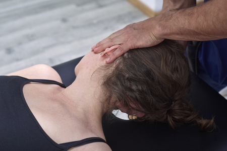 Chiropractic getting mobilization cervical spine of a woman. Manual therapy.  Neurological physical examination. Osteopathy, physiotherapist