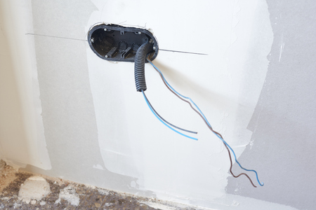 Boxes and cables of new electrical installation. DIY, house indoor improvements room construction Stock Photo