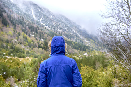 Woman with blue jacket back to the Catalan Pyrenees, Spain, Beautiful mountains. Stock Photo