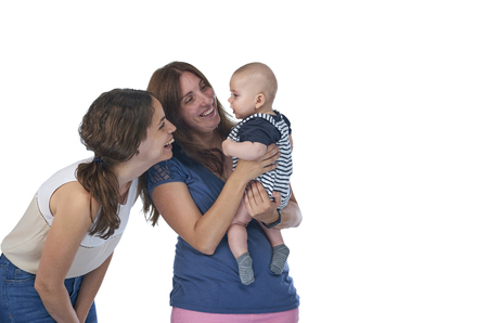 Lesbian mothers with their baby. Homosexual family, lesbian love Stock Photo
