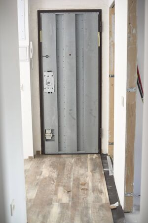 The process of installing laminate wooden on the floor. Home in construction. Stock Photo