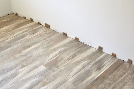 The process of installing laminate wooden on the floor.