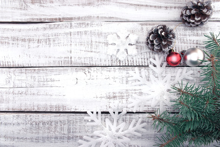 Christmas decoration frame on white rustic wooden background with copy space for text. Christmas background or greeting card. Toned image. Banco de Imagens - 72815547