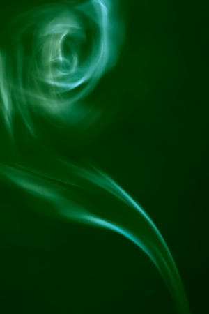 jinn: Green smoke on black background