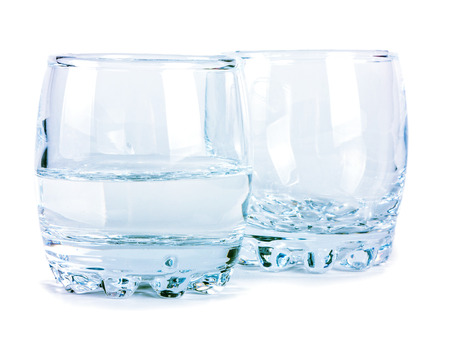 bar ware: Empty and half of water glasses isolated on white background, closeup