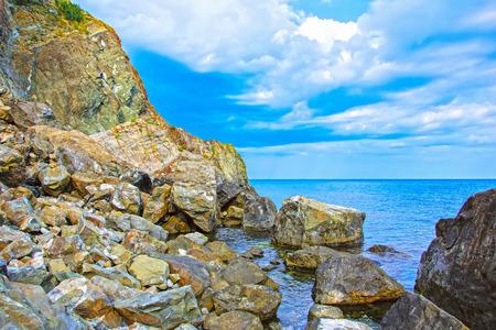 Rock mountain with blue cloudy sky and sea. Crimea, Ukraine