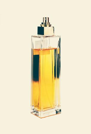 Yellow perfume bottle. Toned in warm tone