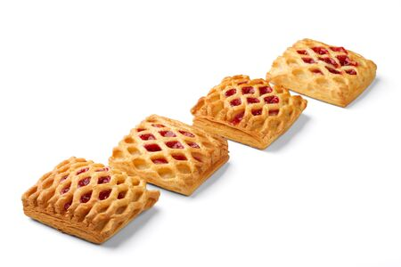 There are four puffs with jam on a white background.