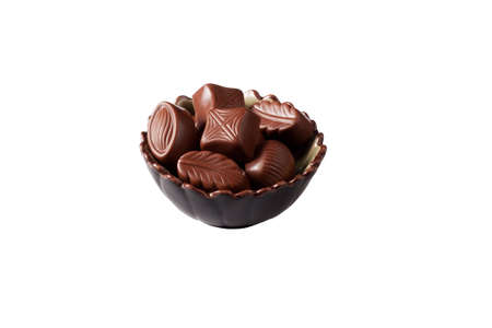 There are the chocolate candies in a nice bowl on a white background with shadow