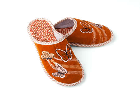 Slippers with butterflies on a white background.