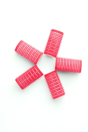 Five red curlers. Top view.