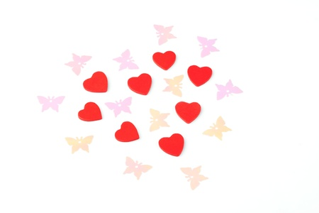 Heart from many little red hearts and butterflies.