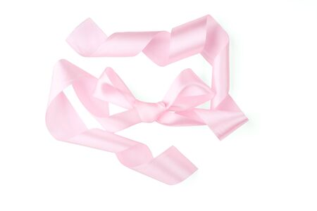 Bow of a pink ribbon on a white background. Stock Photo