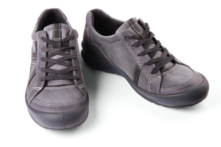 The pair of gray sneakers with stripes.