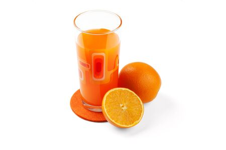 Orange juice in the glass and oranges.