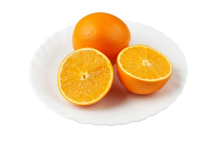 Cutting orange on the white plate