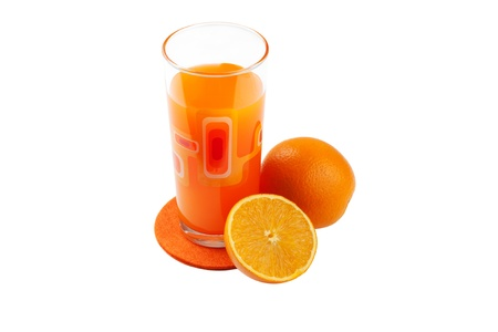 Juice and oranges lying near to a glass Stock Photo