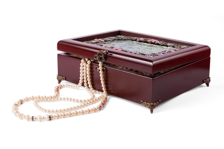 Wooden casket with jewelry. beads lies near to the casket. Stock Photo