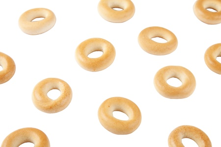 Sprinkled bagels on the white background. Stock Photo