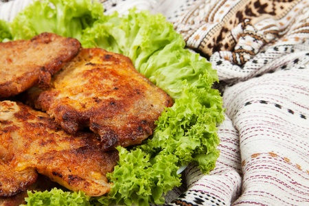 Cutlets on the plate decorated with lettuce