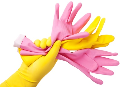 The hand in yellow glove holds three other rubber gloves.