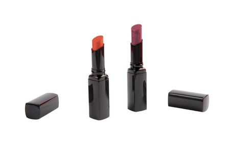 The two open lipsticks: orange and purple.