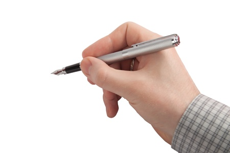 The person writes using the ink pen. Stock Photo