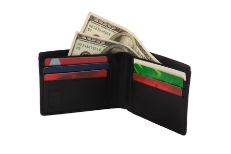 The black wallet with the money and the credit cards Stock Photo