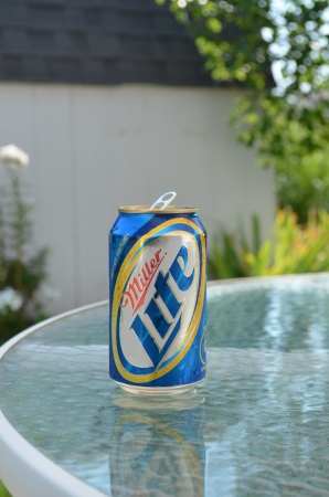 Caledonia, Michigan - August 24, 2012: Miller beer on patio table, close-up Editorial