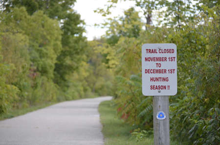 Trail Closed sign along a rural Michigan walking path photo