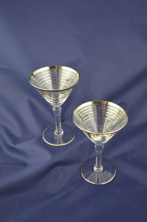 barware: Vintage cocktail glasses on a blue background Stock Photo