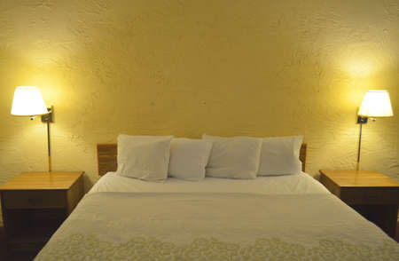 queen bed: Queen size luxury bed with clean white linen and reading lamps Stock Photo