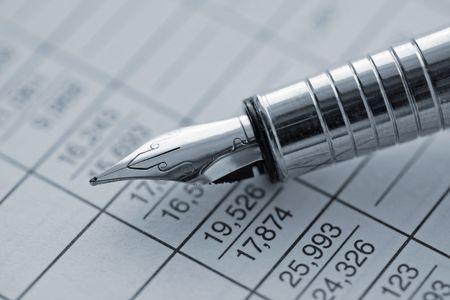 Pen (holder), table of data, statistics Stock Photo