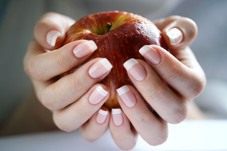 expulsion: Apple in a female hand Stock Photo