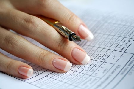 respectable: Holder  in a female hand, table of data, statistics