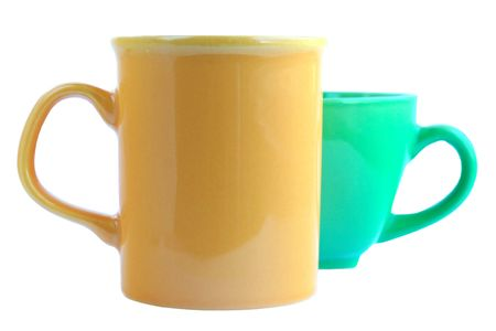 Yellow and green cups on a white background isolated