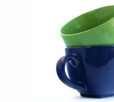 green  and blue cups on a white background
