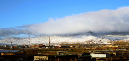 The industrial enterprise on a background of snowy mountains