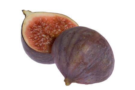 The purple fig cut on two half on a white background, isolated