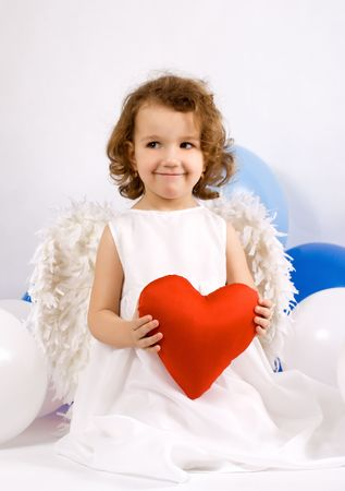 A little angel-girl With red heart in hands, colour balloon around